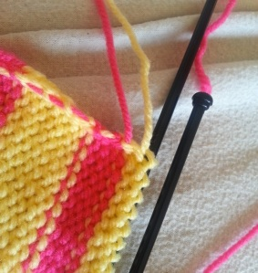 Here you can see how knit the edges are with the unused yarn being woven up the side.