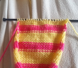 Once you get to the end of the row you will have the unused yarn on the left and the working yarn on the right.  Simply knit another row as normal.  Repeat the process when you start the next row.